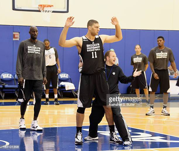 Assisstant coach Lawrence Frank Kevin Garnett and Brook Lopez of the Brooklyn Nets practice during NBATV's Real Training Camp in Durham North...