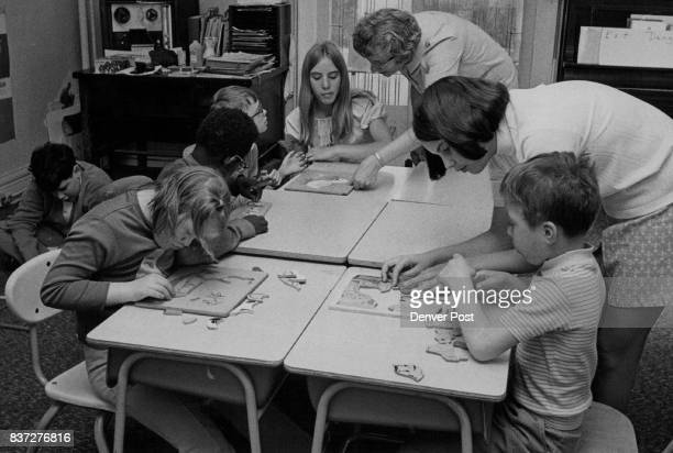 Assistance given by from left Sue Johnson Mrs Doris McGregor and Nancy Anderson makes play period also a time of instructor for children Credit...