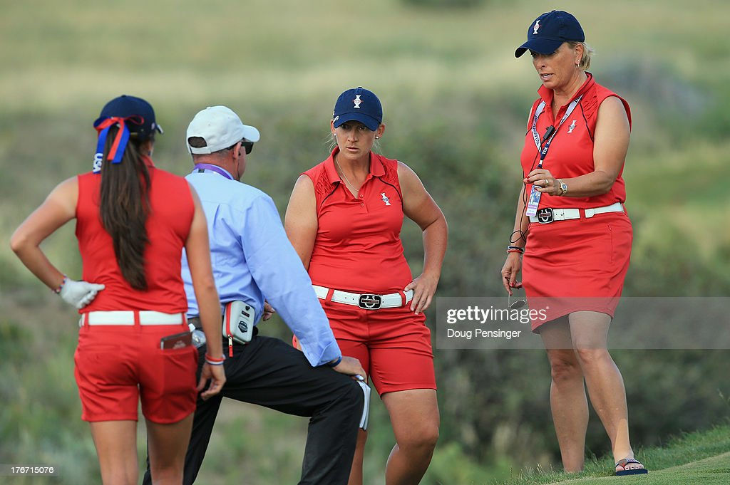 Assistant captain Dottie Pepper (R) questions a ruling on the ball of Angela Stanford (2R) of the United States Team on the 16th hole as Stanford and teammate Gerina Piller (L) of the United States Team where defeated by Carlota Ciganda of Spain and Azahara Munoz of Spain and the European Team during the afternoon four-ball matches at the 2013 Solheim Cup on August 17, 2013 at the Colorado Golf Club in Parker, Colorado.