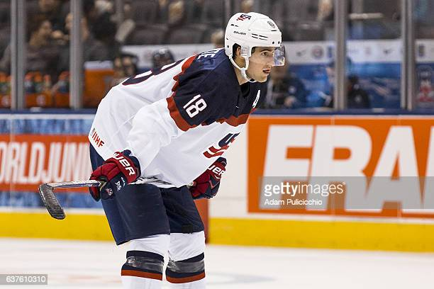 Assistant Captain forward Colin White of Team United States gets into position in a preliminary round Group B game during the IIHF World Junior...