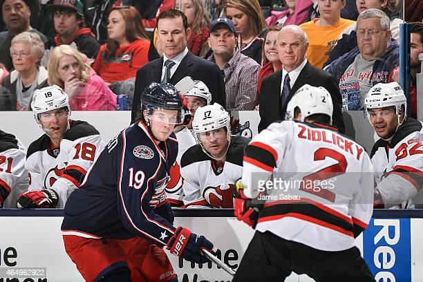 Assistant Coach Adam Oates left and President and General Manager Lou Lamoriello both of the New Jersey Devils watch their team play against the...