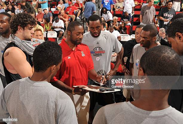Assistant coach Adrian Griffin of the Milwaukee Bucks draws up a play against the Chicago Bulls during NBA Summer League presented by EA Sports on...