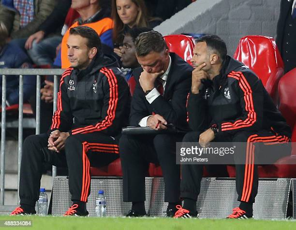 Assistant coach Albert Stuivenberg Manager Louis van Gaal and Assistant Manager Ryan Giggs of Manchester United watch from the dugout during the UEFA...