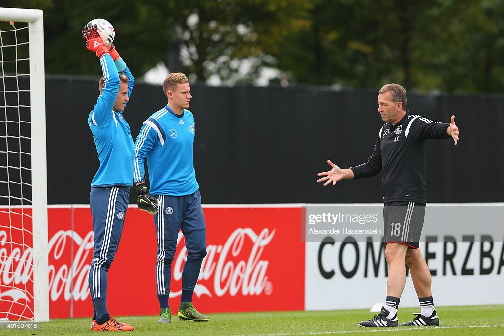 Assistant coach Andreas Koepcke talks to his players <a gi-track='captionPersonalityLinkClicked' href=/galleries/search?phrase=Marc-Andre+ter+Stegen&family=editorial&specificpeople=5528638 ng-click='$event.stopPropagation()'>Marc-Andre ter Stegen</a> (L) and <a gi-track='captionPersonalityLinkClicked' href=/galleries/search?phrase=Bernd+Leno&family=editorial&specificpeople=5528639 ng-click='$event.stopPropagation()'>Bernd Leno</a> during a training session of the German national football team at Commerzbank Arena on October 6, 2015 in Frankfurt am Main, Germany.