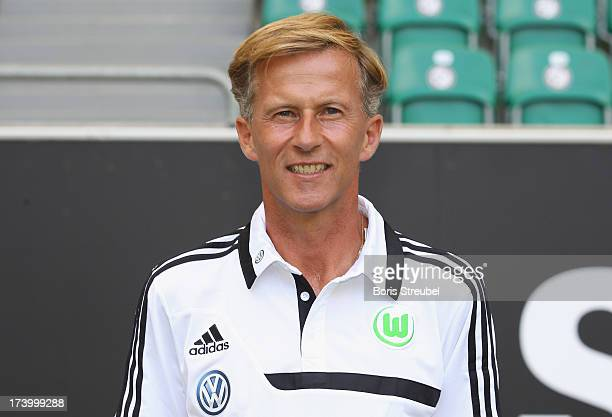 Assistant coach Andries Jonker of VfL Wolfsburg poses during the Bundesliga team presentation of VfL Wolfsburg at Volkswagen Arena on July 18 2013 in...