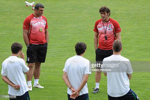 Assistant coach Angelo Peruzzi and head coach Ciro Ferrara of Italy speak with players during an Italian U21 training session at Stade de Bon...