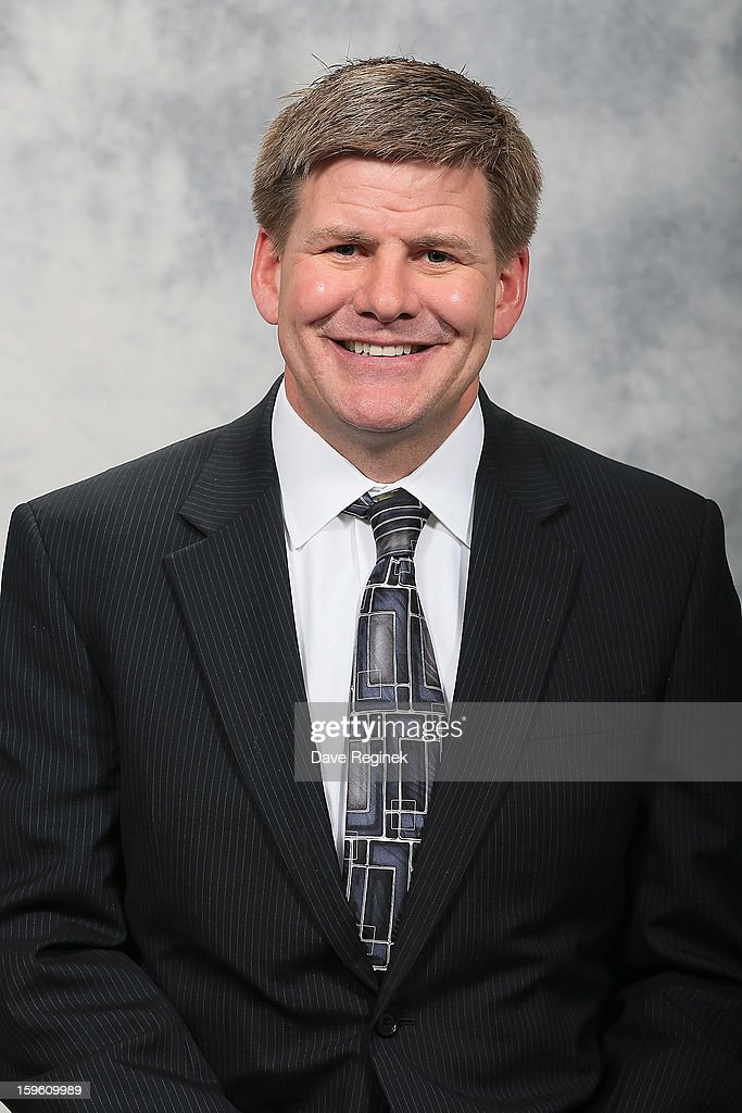 Assistant Coach Bill Peters of the Detroit Red Wings poses for his official headshot for the 2012-2013 season at Compuware Ice Arena on January 13, 2013 in Plymouth, Michigan.