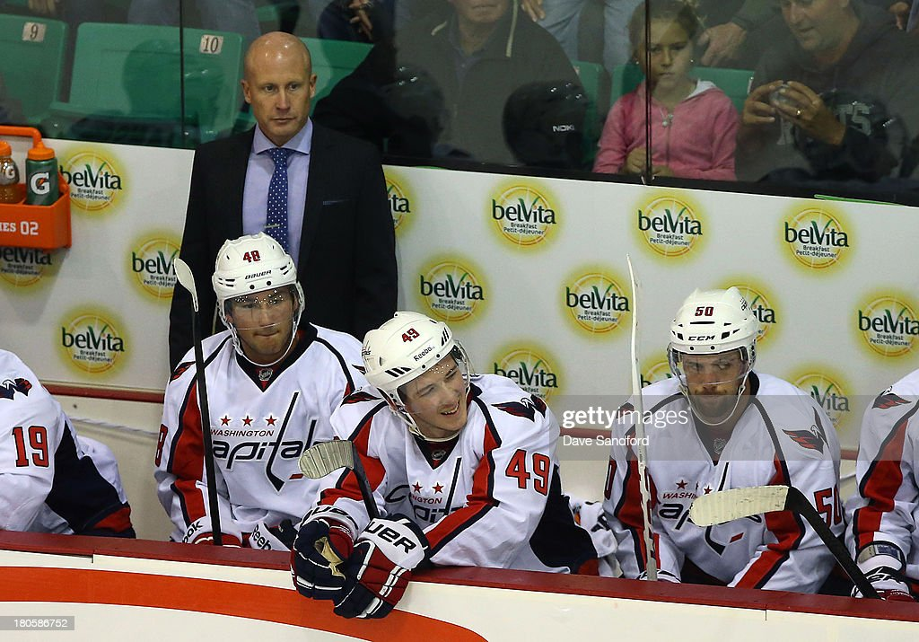 Assistant Coach Blaine Forsythe of the Washington Capitals stands on the bench as they face the Winnipeg Jets in his first game as assistant coach during Kraft Hockeyville Day 2 at Yardmen Arena on September 14, 2013 in Belleville, Ontario, Canada.