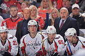 Assistant Coach Blaine Forsythe of the Washington Capitals watches gameplay as head Coach Barry Trotz of the Washington Capitals instructs his team...
