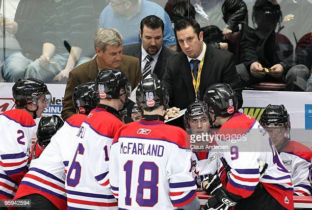 Assistant coach Bob Boughner of Team Orr goes over a play as head coach Bobby Orr and Bob Jones look on during the Home Hardware CHL/NHL Top...