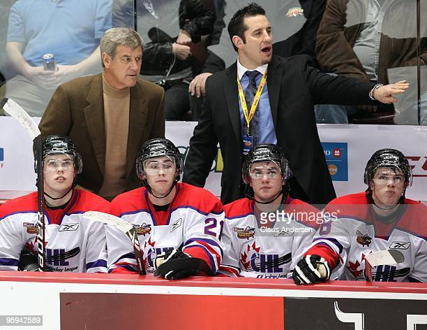 Assistant coach Bob Boughner of Team Orr points at a play as head coach Bobby Orr looks on in the Home Hardware CHL/NHL Top Prospects game against...