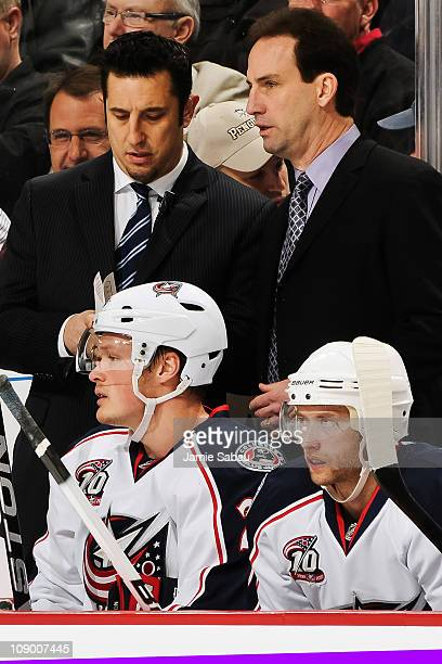 Assistant Coach Bob Boughner of the Columbus Blue Jackets confers with Head Coach Scott Arniel of the Columbus Blue Jackets during a game against the...