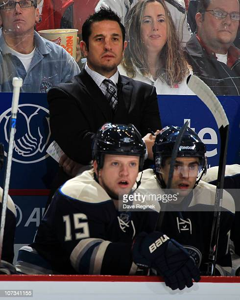 Assistant coach Bob Boughner of the Columbus Blue Jackets watches the game action from behind the bench during an NHL game against the Detroit Red...