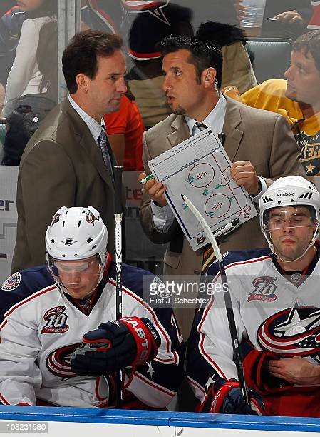 Assistant coach Bob Boughner talks to head coach Scott Arniel of the Columbus Blue Jackets during a break in action against the Florida Panthers on...