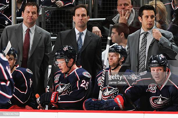 Assistant Coach Brad Berry left Head Coach Scott Arniel middle and Assistant Coach Bob Boughner all of the Columbus Blue Jackets watch the final...