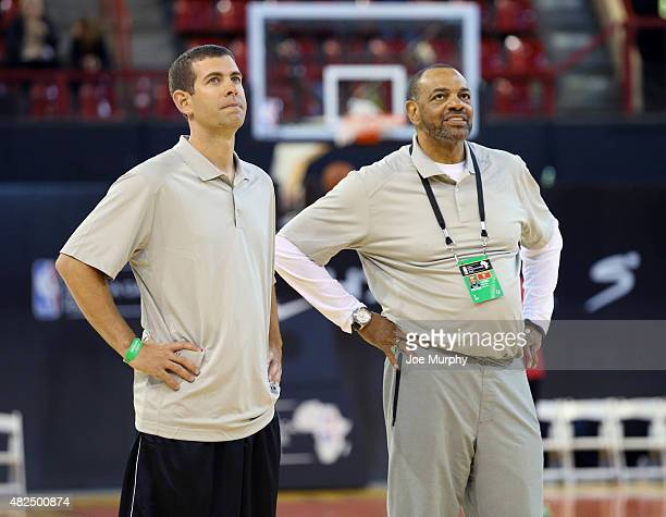 Assistant Coach Brad Stevens of Team World with Head Coach Lionel Hollins of Team World during practice for the NBA Africa Game 2015 as part of...