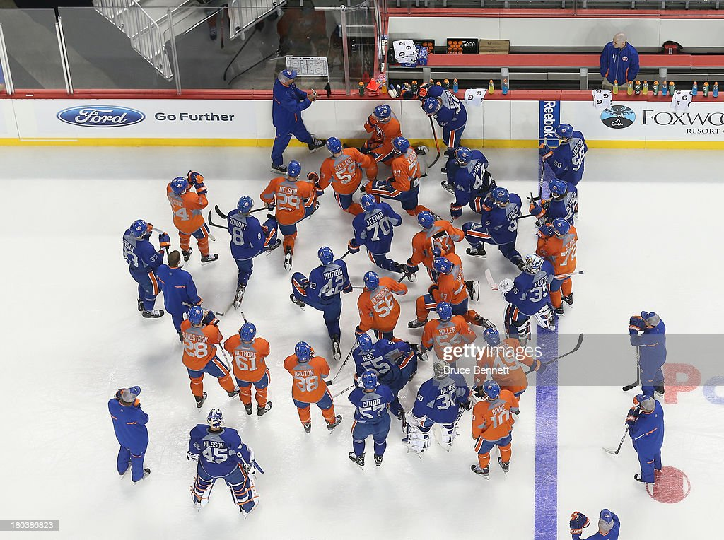 Assistant coach Brent Thompson of the New York Islanders leads the team during their first practice at the Barclays Center on September 12, 2013 in Brooklyn borough of New York City. The Islanders are due to move into the building at the start of the 2015-16 season.
