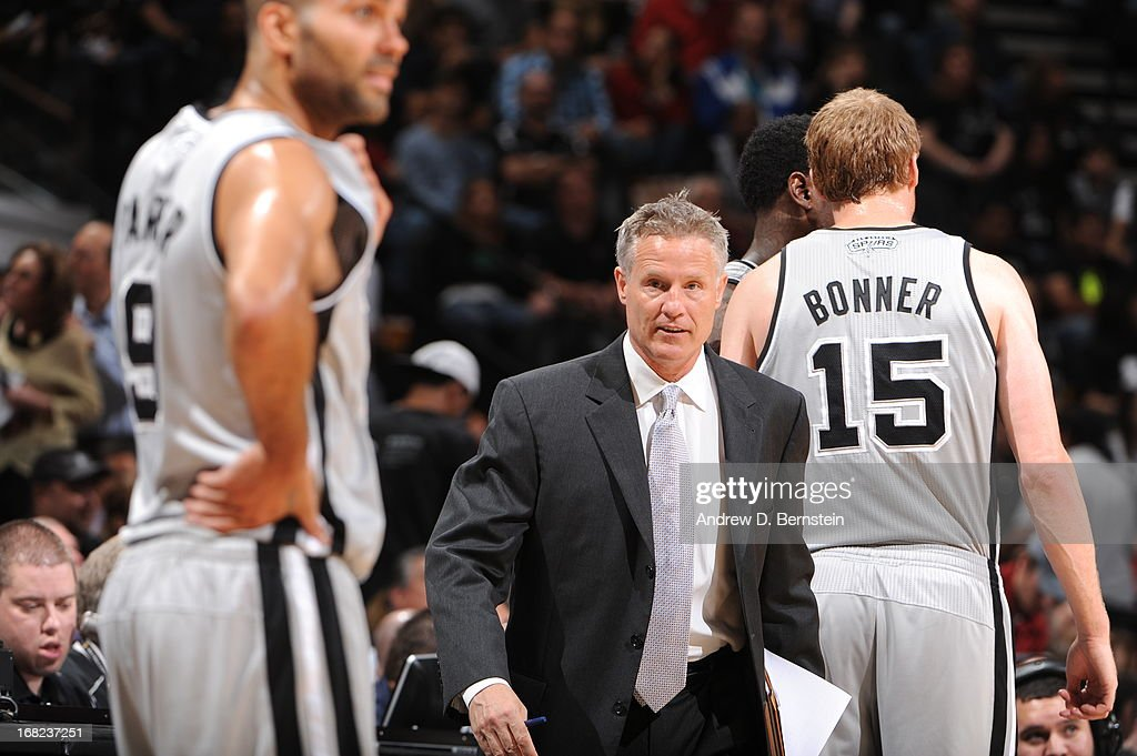 Assistant coach Brett Brown of the San Antonio Spurs during the game against the Golden State Warriors in Game One of the Western Conference Semifinals during the 2013 NBA Playoffs on May 6, 2013 at the AT&T Center in San Antonio, Texas.