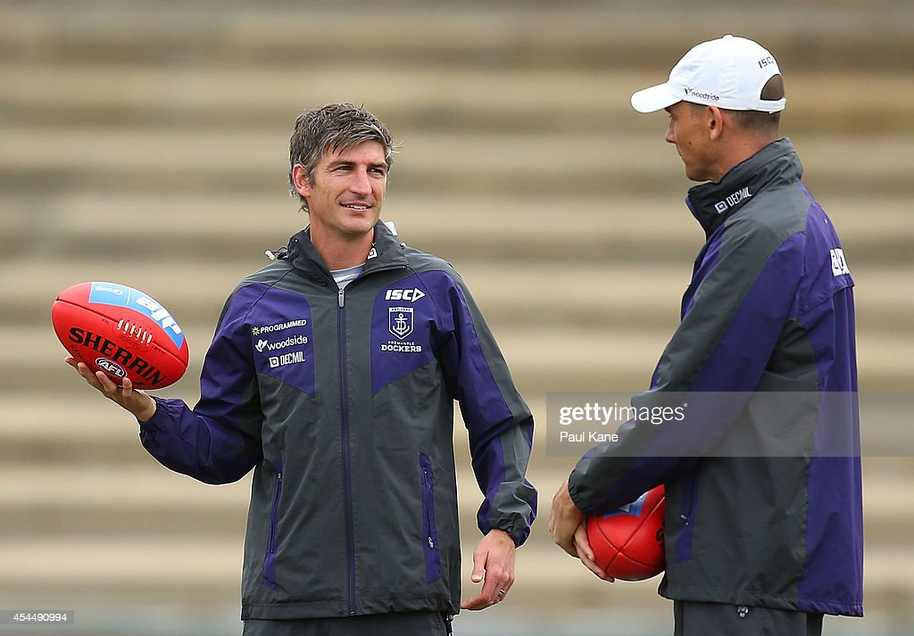 Assistant coach Brett Kirk talks with ruck coach Simon Eastaugh during a Fremantle Dockers AFL training session at Fremantle Oval on September 2 2014...