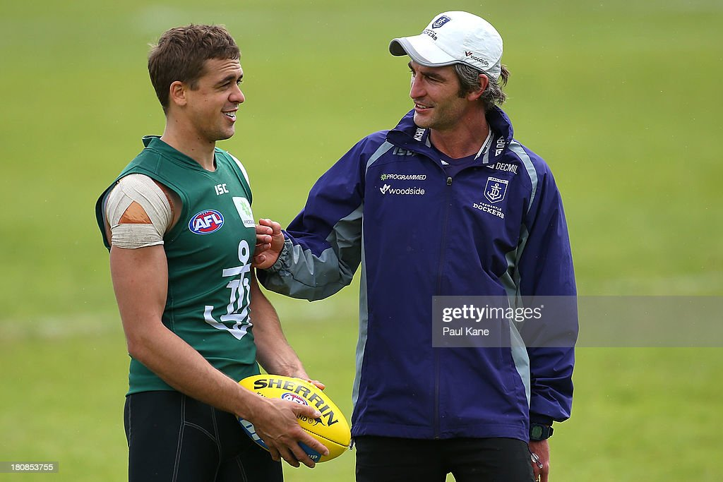Assistant coach Brett Kirk talks with Stephen Hill during a Fremantle Dockers AFL training session at Fremantle Oval on September 17 2013 in...