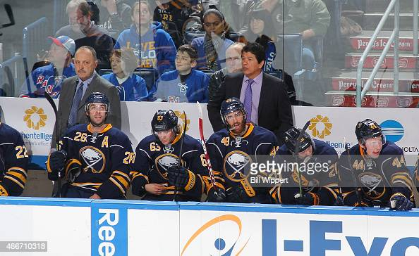 Assistant coach Bryan Trottier and head coach Ted Nolan of the Buffalo Sabres watch the action against the New York Rangers on March 14 2015 at the...