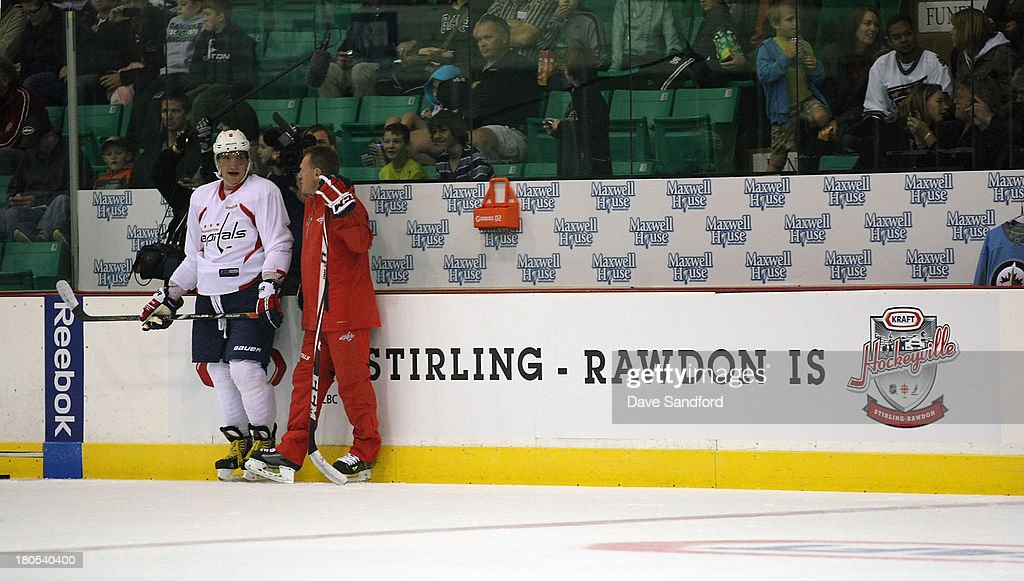 Assistant Coach Calle Johansson talks with Alexander Ovechkin #8 both of the Washington Captials at Yardman Arena during Kraft Hockeyville Day 2 on September 14, 2013 in Stirling, Ontario, Canada.