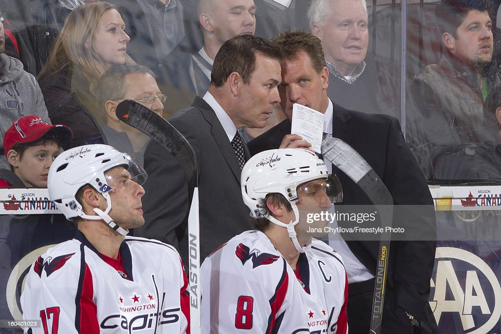 Assistant coach Calle Johansson talks with head coach Adam Oates of the Washington Capitals during an NHL game against the Ottawa Senators at Scotiabank Place on January 29, 2013 in Ottawa, Ontario, Canada.