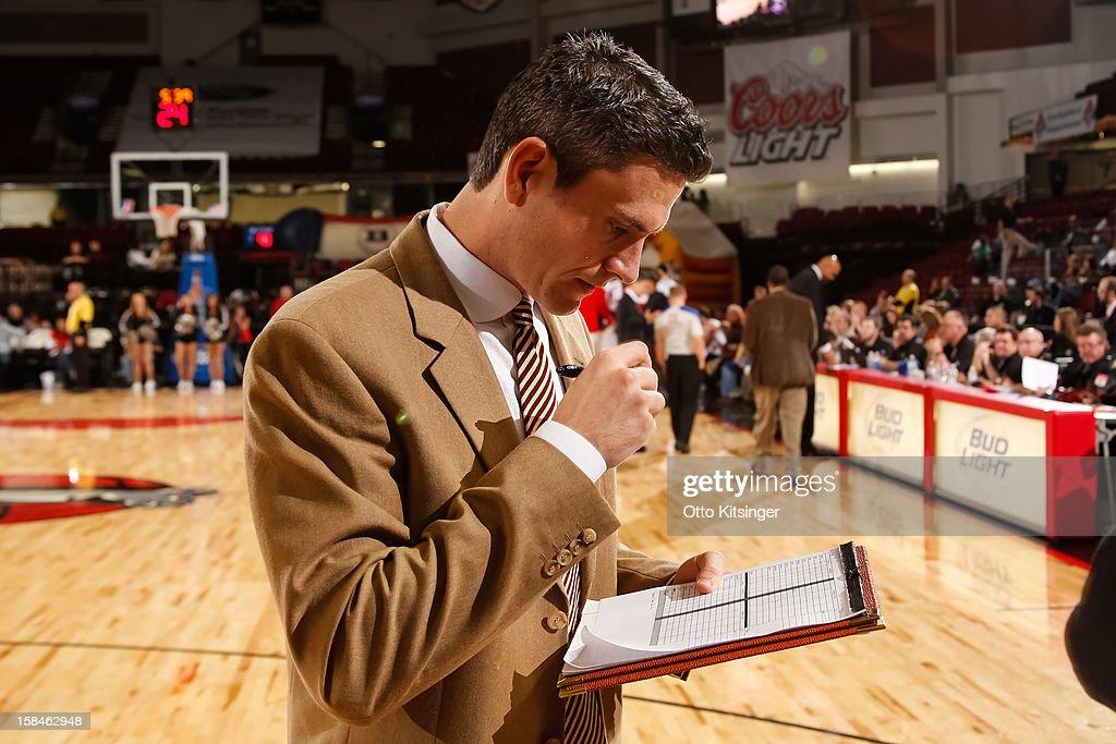 Assistant Coach Casey Hill of the Santa Cruz Warriors checks the stats during a time out against the Idaho Stampede on December 15, 2012 at CenturyLink Arena in Boise, Idaho.