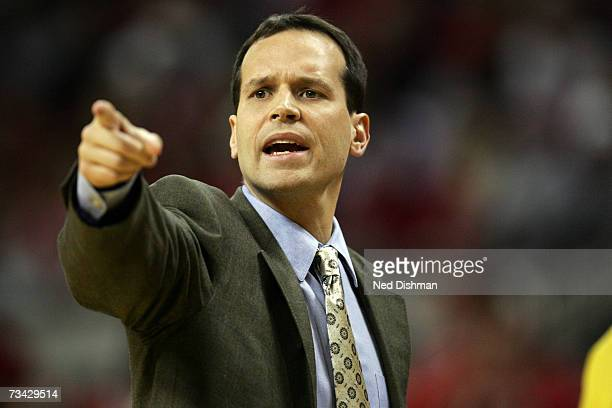 Assistant coach Chris Collins of the Duke University Blue Devils points towards the court against the University of Maryland Terrapins at the Comcast...