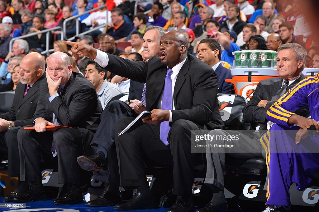 Assistant coach Chuck Person of the Los Angeles Lakers calls out a play during the game against the Philadelphia 76ers on December 16, 2012 at the Wells Fargo Center in Philadelphia, Pennsylvania.