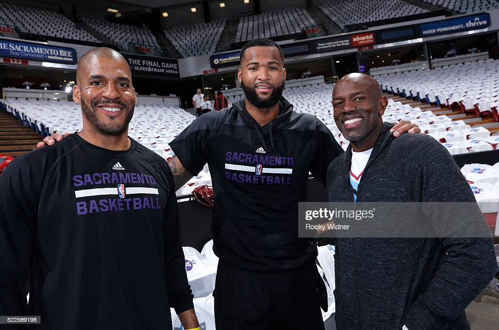Assistant coach Corliss Williamson and DeMarcus Cousins of the Sacramento Kings pose for a photo with former NBA player Tony Delk on April 9 2016 at...