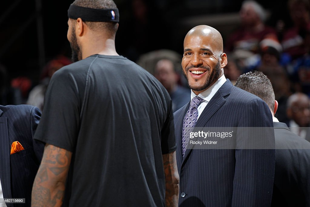Assistant coach Corliss Williamson of the Sacramento Kings coaches against the Cleveland Cavaliers on January 30 2015 at Quicken Loans Arena in...
