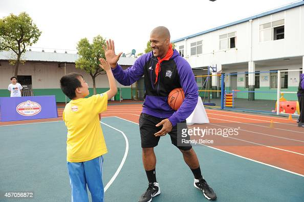 Assistant Coach Corliss Williamson of the Sacramento Kings participates during the 2014 NBA Global Games NBA Cares Learn and Play Center dedication...