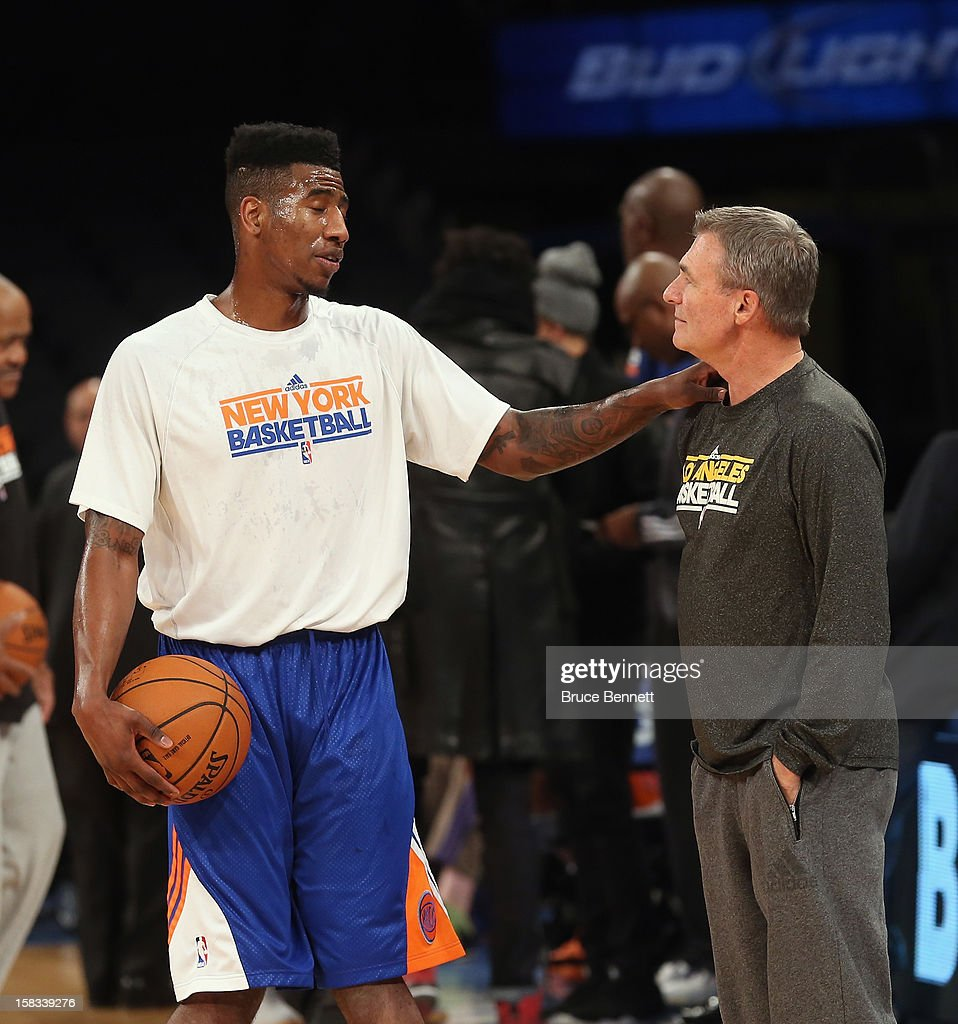 Assistant coach Dan D'Antoni of the Los Angeles Lakers speaks with Iman Shumpert #21 of the New York Knicks prior to the game at Madison Square Garden on December 13, 2012 in New York City.