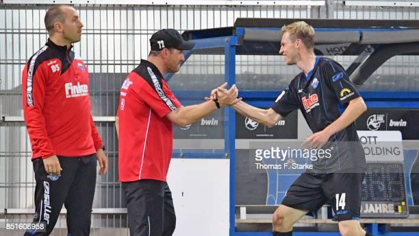 Assistant coach Daniel Scherning head coach Steffen Baumgart and Thomas Bertels of Paderborn celebrate during the 3 Liga match between SC Paderborn...