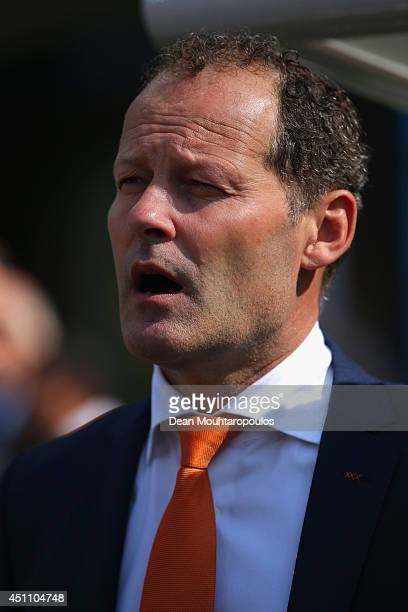 Assistant coach Danny Blind sings the National Anthem prior to the 2014 FIFA World Cup Brazil Group B match between the Netherlands and Chile at...