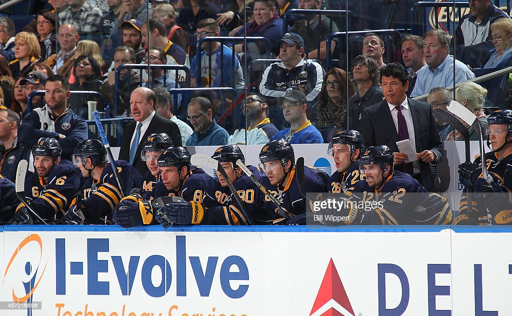 Assistant coach Danny Flynn and head coach Ted Nolan of the Buffalo Sabres watch the action against the Columbus Blue Jackets on October 9 2014 at...