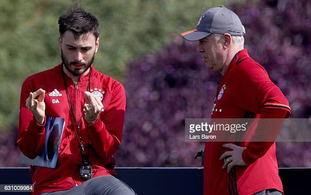 Assistant coach Davide Ancelotti and head coach Carlo Ancelotti smile during a training session at day 3 of the Bayern Muenchen training camp at...