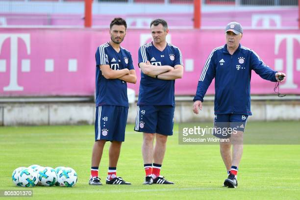 Assistant coach Davide Ancelotti assistant coach Willy Sagnol and head coach Carlo Ancelotti of FC Bayern Muenchen stand next to each other during a...