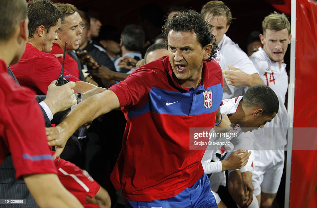 Assistant coach Dejan Govedarica (C) of Serbia attempts to keep the opposing players apart during a scuffle after the Under 21 European Championship Play Off second leg match between Serbia U21 and England U21 at Stadium Mladost on October 16, 2012 in Krusevac, Serbia.