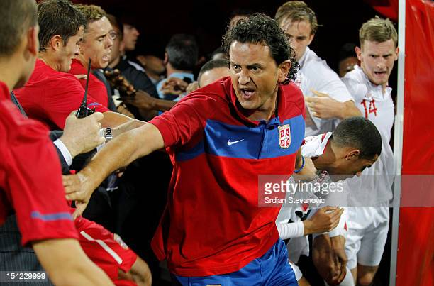 Assistant coach Dejan Govedarica of Serbia attempts to keep the opposing players apart during a scuffle after the Under 21 European Championship Play...