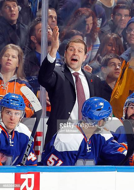 Assistant Coach Doug Weight of the New York Islanders on the bench during the game against the Colorado Avalanche on February 8 2014 at Nassau...