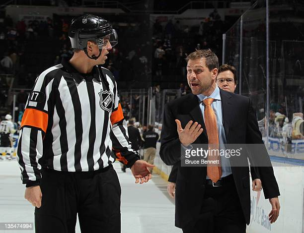 Assistant coach Doug Weight of the New York Islanders speaks with referee Frederick L'Ecuyer after the Isles game against the Pittsburgh Penguins at...