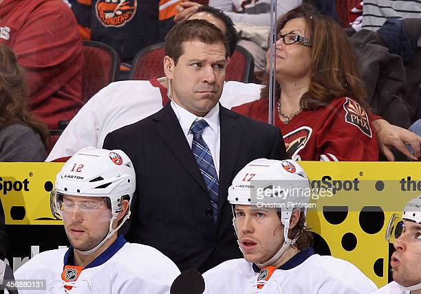 Assistant Coach Doug Weight of the New York Islanders watches from the bench during the NHL game against the Phoenix Coyotes at Jobingcom Arena on...