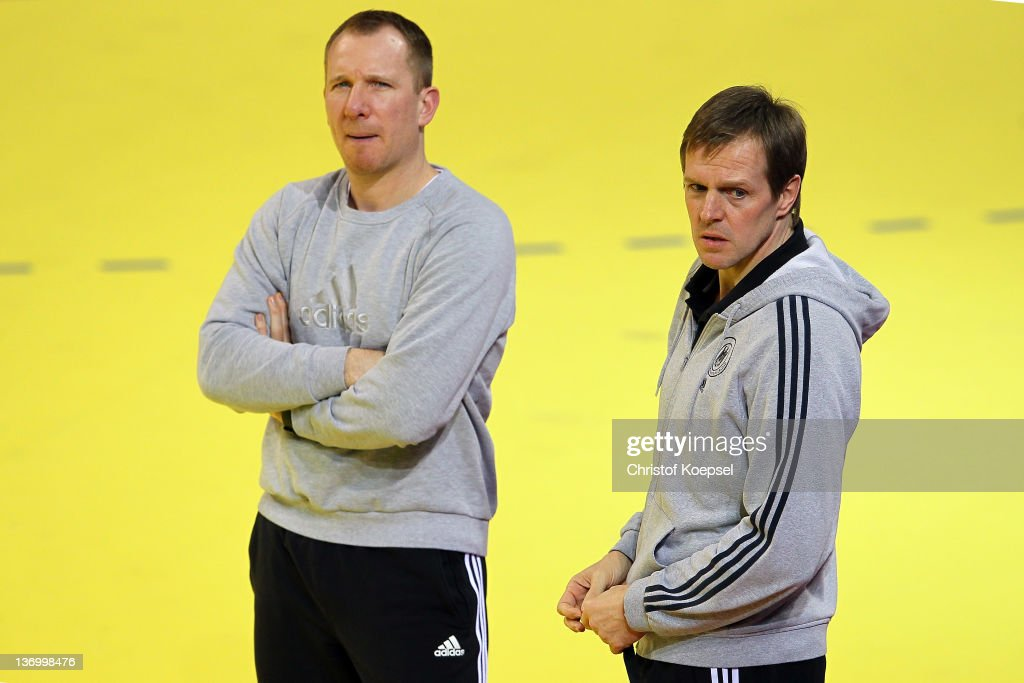 Assistant coach Frank Carstens and head coach <a gi-track='captionPersonalityLinkClicked' href=/galleries/search?phrase=Martin+Heuberger&family=editorial&specificpeople=2084797 ng-click='$event.stopPropagation()'>Martin Heuberger</a> watch the Germany training session at Cair Sports Centre on January 14, 2011 in Nis, Serbia.