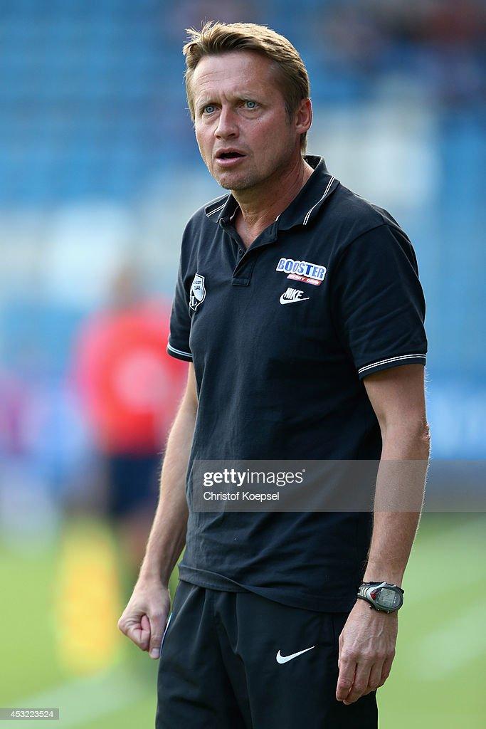 Assistant coach Frank Heinemann of Bochum loosk thoughtful during the pre-season friendly match between VfL Bochum and FC Schalke 04 at Rewirpower Stadium on August 5, 2014 in Bochum, Germany.