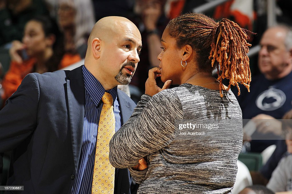 Assistant coach Fred Chmiel talks to head coach Coquese Washington of the Penn State Lady Lions during a break in action against the Miami Hurricanes on November 29, 2012 at the BankUnited Center in Coral Gables, Florida. Miami defeated Penn State 69-65.
