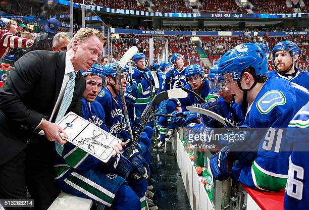 Assistant coach Glen Gulutzan of the Vancouver Canucks discusses strategy with seconds remaining against the New York Islanders during their NHL game...