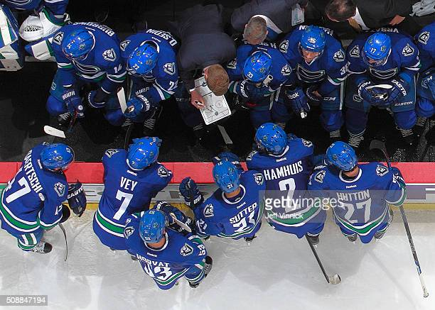 Assistant coach Glen Gulutzan of the Vancouver Canucks draws out a play during the late stages of their NHL game against the Calgary Flames at Rogers...
