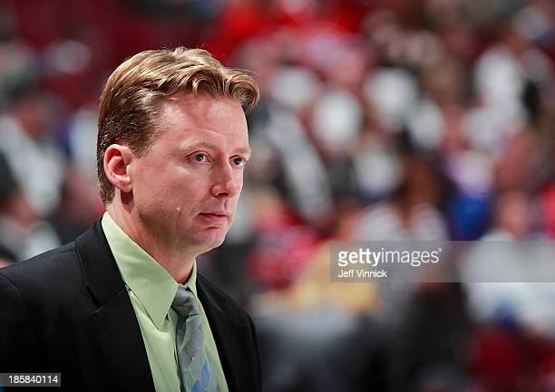 Assistant coach Glen Gulutzan of the Vancouver Canucks looks on from the bench during their NHL game against the Montreal Canadiens at Rogers Arena...